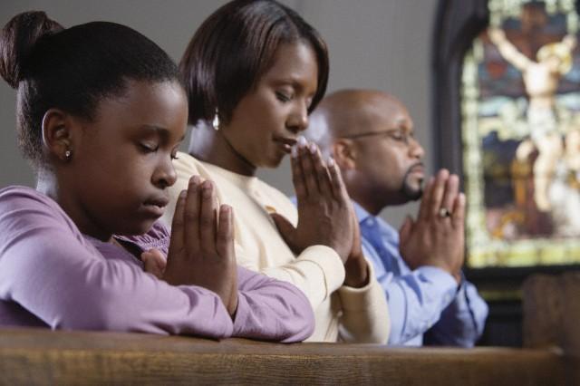 Family praying in church